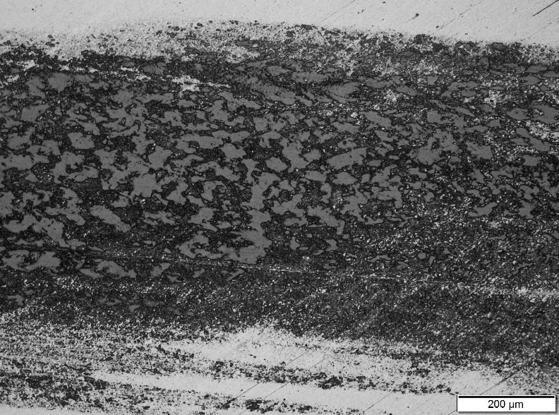 100x Optical image of the wear zone with severe galling (Hardened M2 pin)